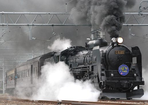 black-train-on-rail-and-showing-smoke-72594
