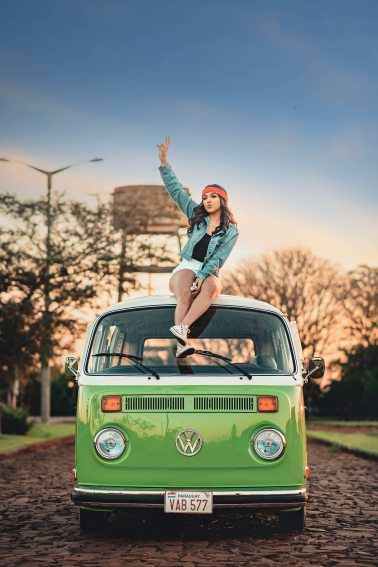 woman-sitting-on-top-of-volkswagen-2845631