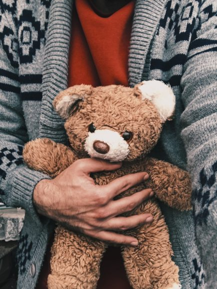 person-holding-brown-bear-plush-toy-3693367