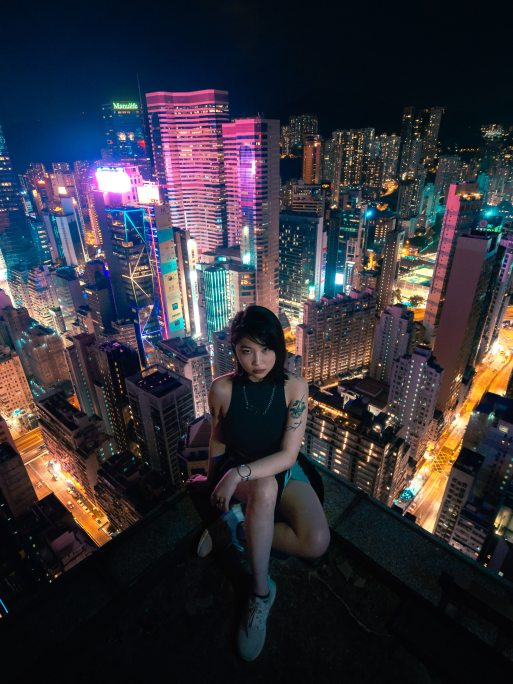 photo-of-woman-sitting-on-rooftop-1738975