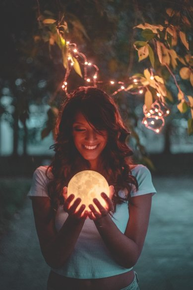 smiling-woman-holding-moon-1343259